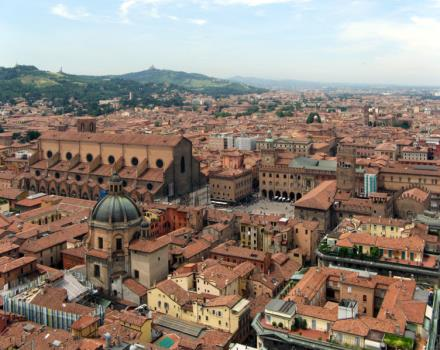 You can see the red roofs of Bologna